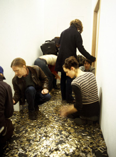 The artists were locked inside the gallery with thousands of keys spread on the floor outside of the space.  Artists communicated with the public via spy camera/microphone while viewers attempted to gain access to the space.